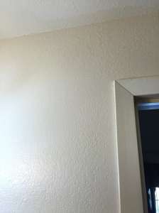 Looking at the ceiling I noticed this bathroom was three different colors. WTF?